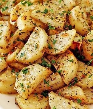 Ingredients :  butter, for greasing the pan  2 pounds russet potatoes  ¼ cup olive oil (preferably extra-virgin but it doesn't have to be), divided  1 teaspoon Italian seasoning, crushed between fingertips  4 minced cloves garlic  salt and pepper  ¼ cup grated Parmesan