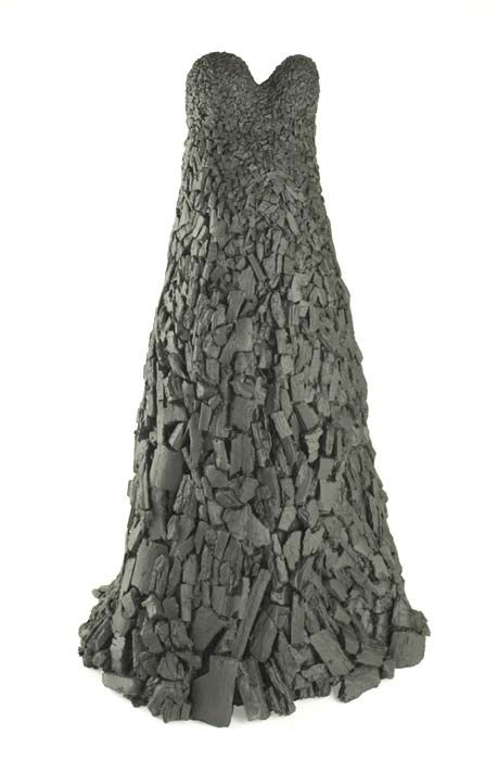 """Jennifer Hecker ~ """"Martyr Dress 1"""" (2007-2010) lump charcoal, bra, glue, resin, paint over a metal armature 55.5 x 36 x 50 in. """"The dress made of lump charcoal is both a strapless, black gown and a funeral pyre. It refers to both the transience of beauty and the sacrifices made for beauty.""""~JH via jenniferhecker.net"""