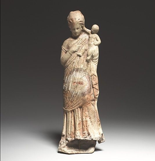 Terracotta statuette of a woman holding a baby  Period: Late Hellenistic Date: 2nd–1st century B.C. Culture: Greek, Asia Minor, Myrina (?) Medium: Terracotta Dimensions: H. 8 7/16 in. (21.4 cm) Classification: Terracottas Credit Line: The Cesnola Collection, Purchased by subscription, 1874–76 Accession Number: 74.51.1729