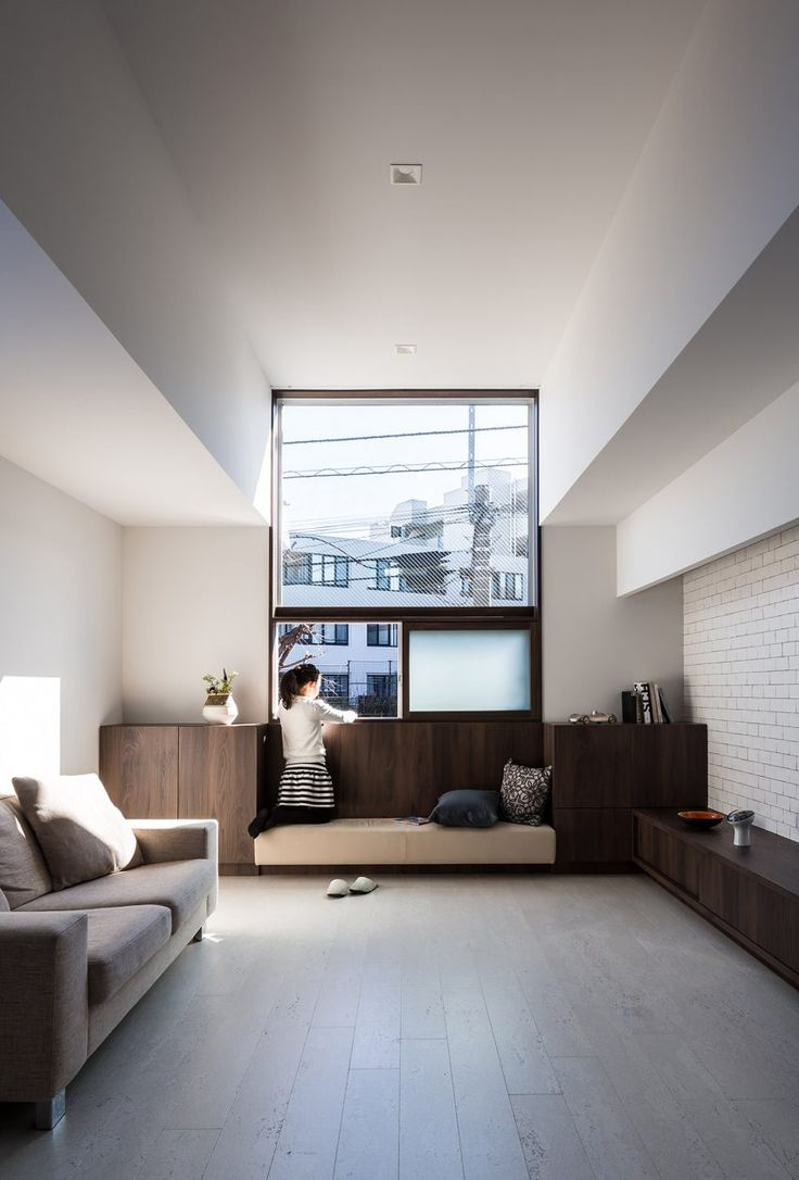 """""""The appearance has been designed to create both a massive and floaty feel,"""" said studio director Kouichi Kimura, who had to comply with strict building height regulations when designing the 97-square-metre home."""