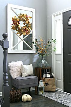 Small Entryway Decorating Ideas for fall using budget items. Create a stylish foyer with this small entryway bench and many other creative items.