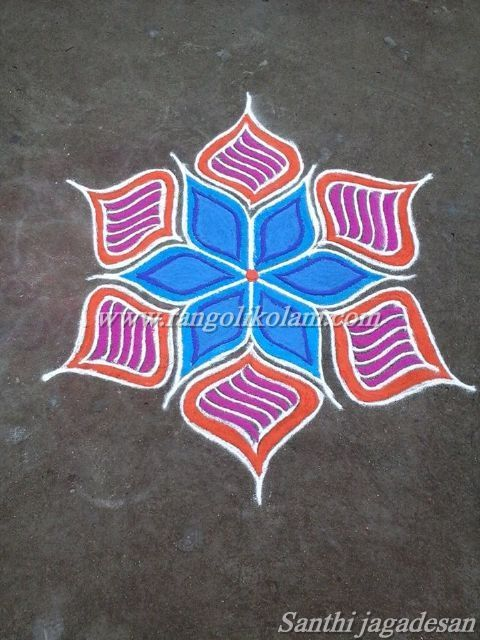 Small flower colour kolam in freehand style done by Santhi jagadesan