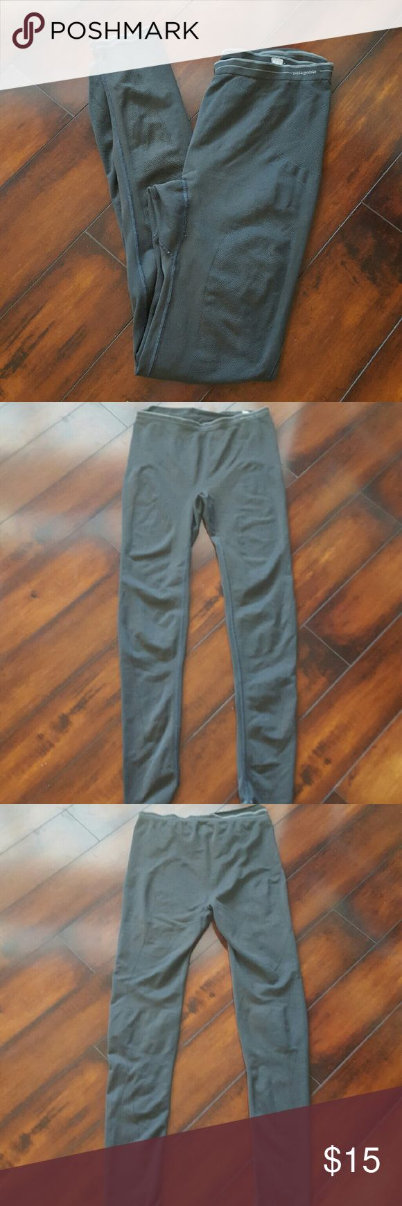 Men's Patagonia athletic pants, size large Men's dark grey Patagonia tight athletic pants, size large.  These hug your skin like tight long Johns would do.  No outside stains. Patagonia Pants Sweatpants & Joggers