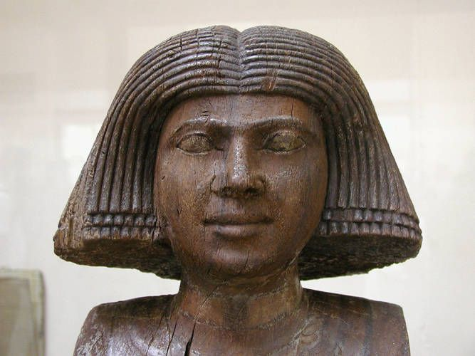 "Ancient Egyptian wooden statue depicting the wife of Ka-Aper ""Sheik el-Beled"""