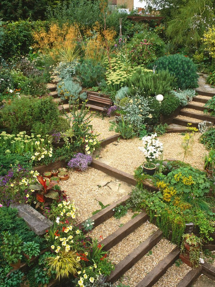 Terracing creates multiple garden zones and is the perfect solution for a hilly landscape. This gorgeous garden leaves plenty of bench space to take in the sights and sounds.