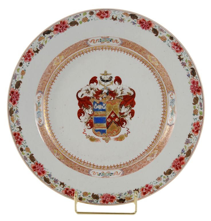 Chinese Export Porcelain Armorial Charger -   circa 1725, Arms of Mertins impaling Peck of Essex and Norfolk, inner cell-diaper and gilt-spear borders with scholar's objects, famille rose rim border, 10-7/8 in.,    generally good condition, very small repair to rim      Lot Notes: Sir George Mertins was Lord Mayor of London at the time the service was made. Literature: David S. Howard, Chinese Armorial Porcelain, vol. I, page 213