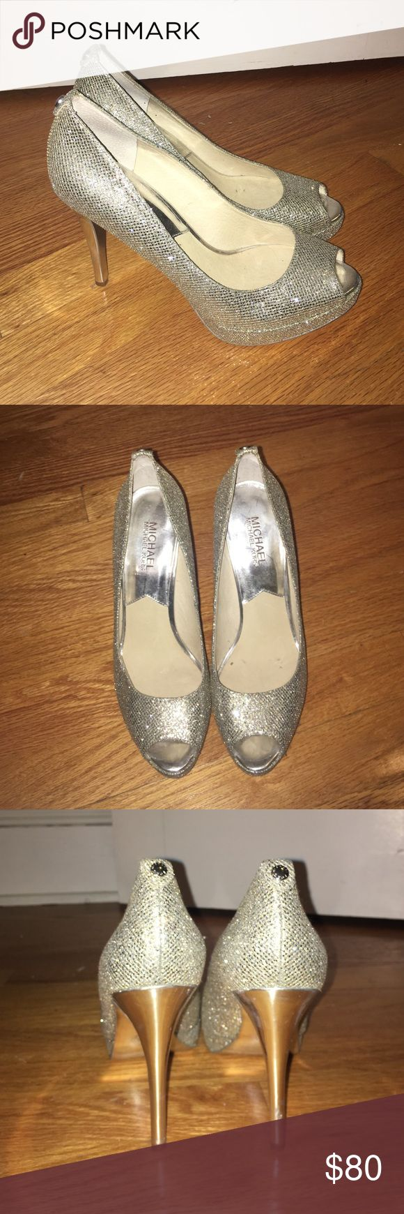 """MICHAEL KORS silver sparkle 4 1/2"""" heels SIZE 8.5 ONLY WORN ONCE these are the perfect shoes for ANY special occasion such as prom sweet 16 or quinceñera & they look amazing. Note: heels look cooper/gold in the picture. They are silver and just reflecting the floor MICHAEL Michael Kors Shoes Heels"""