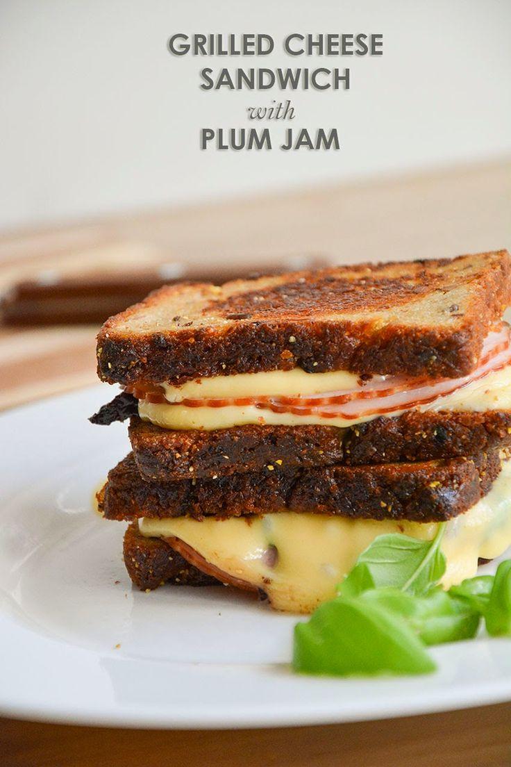Grilled Cheese Sandwich with plum jam. Zapiekana Kanapka Serowa z powidłami śliwkowymi.  2 slices wholemeal bread 1 tsp butter  1 tsp plum jam 1 pound honey smoked ham deli meat, shaved 2 slices  ham fresh basil