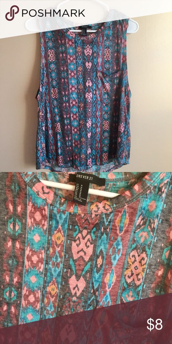 Tribal Print Muscle Tee Fun Pattern Tribal Print Muscle Tank! Thin, breathable material, cute for a casual jean or shorts outfit! Forever 21 Tops Muscle Tees