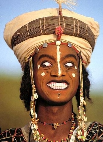 Africa | Wodaabe man participating in the Yaake dance, launching into a series of wildly exaggerated facial expressions. Gerewol festival, Niger | ©Carol Beckwith and Angela Fisher