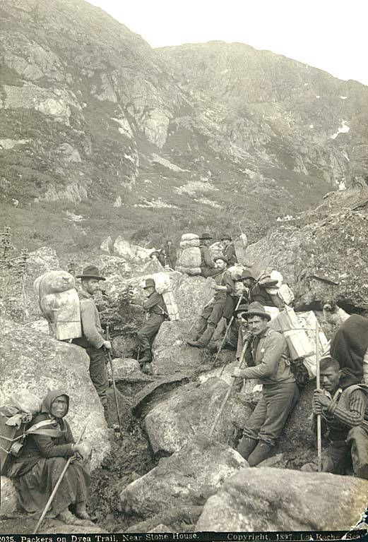 Klondikers and Indian packers near Stone House, Chilkoot Trail, Alaska, 1897.