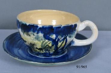91/965 Teacup and saucer, earthenware, made by Arthur Merric Boyd Pottery and hand-painted by Neil Douglas, Murrumbeena, Victoria, Australia, 1950-1960 - Powerhouse Museum Collection