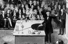 Michael Faraday delivering a Christmas Lecture at the Royal Institution in 1856.