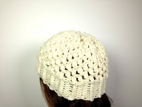 Loom Knit a Popcorn Hat (NOTE: Use a loom that fits your head and NOT the one used in the tutorial!... Make this pattern wider and longer to make a bag with a draw-string inserted in the rim.. Deb)