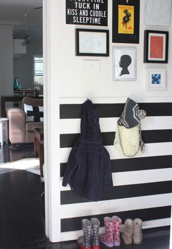 love the black and white mudroom with horizontal stripes