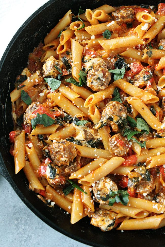 One Pot Sausage Pasta Recipe on twopeasandtheirpod.com This easy one pot pasta is a weeknight dinner favorite! You can have it on the dinner table in 30 minutes!