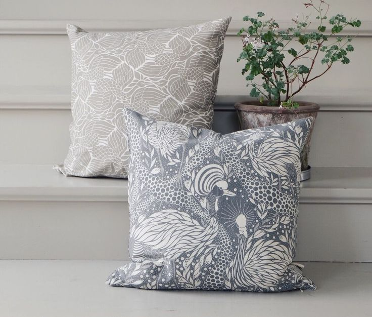 Cushion cover Prancing Peacock grey via Emma von Brömssen. Click on the image to see more!