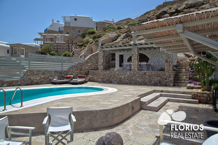 The pool under the shades of the local stone, with the views of the sea is a unique set of the Mykonos Island living. FL1021 Villa for Sale on Mykonos island, Greece. http://www.florios.gr/en/mykonos-property/18.html