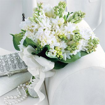 Brides: Classic Color: Green leaves frame the bouquet's white blossoms, making them look even more brilliant