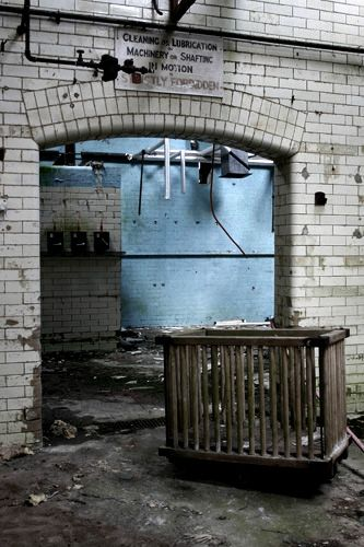 Abandoned: Hellingly Asylum - UK- little playground for children - I can't even imagine putting a child in a cage like an animal.
