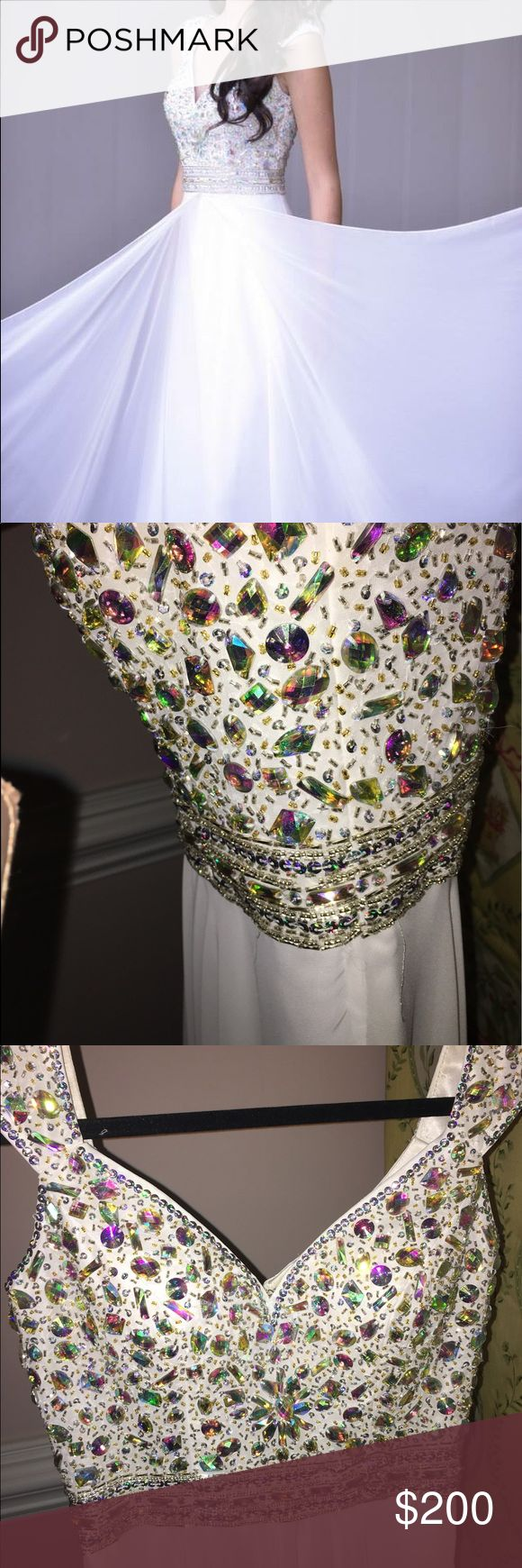 pageant/prom dress, no damages/stains/rips Panoply pageant/prom dress, with AB stones, a split down the front. A V-shaped neck line, with straps that have AB stones on them. panoply Dresses Prom
