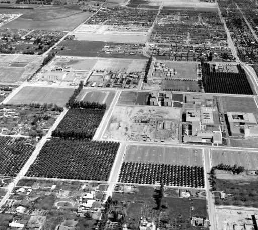 Campus of San Fernando Valley State College (now California State University, Northridge), aerial view looking east from Reseda Blvd., March 11, 1962. Reseda Blvd. in the foreground, the Music Building, Nordhoff Hall on the edge of Nordhoff St., right. Sierra Hall construction site is visible in the center. CSUN University Archives.San Fernando Valley History Digital Library.