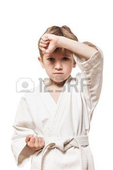 Martial art sport - child boy in white kimono training karate punch photo