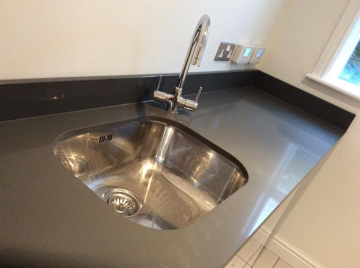 A great little compact undermounted Bluci Rubus 40u kitchen sink.  High Quality 18/10 steel and a lifetime warranty.  Looks great in this solid surface worktop complete with up stands. The Bluci Savio kitchen tap has been fitted at the side of the bowl, probably due to the thickness of the upstands.
