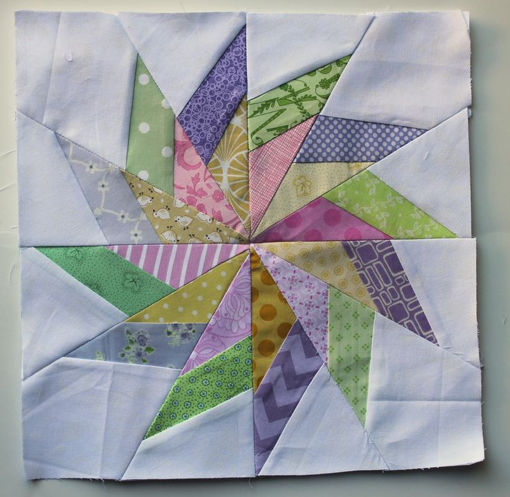 pastel pinwheel finished block pieced on paper.  This is a tutorial with some nice tips.  However, I recommend the add-a-quarter ruler to trim seam allowances.  Learn to use it properly and you will never be without it for foundation piecing!