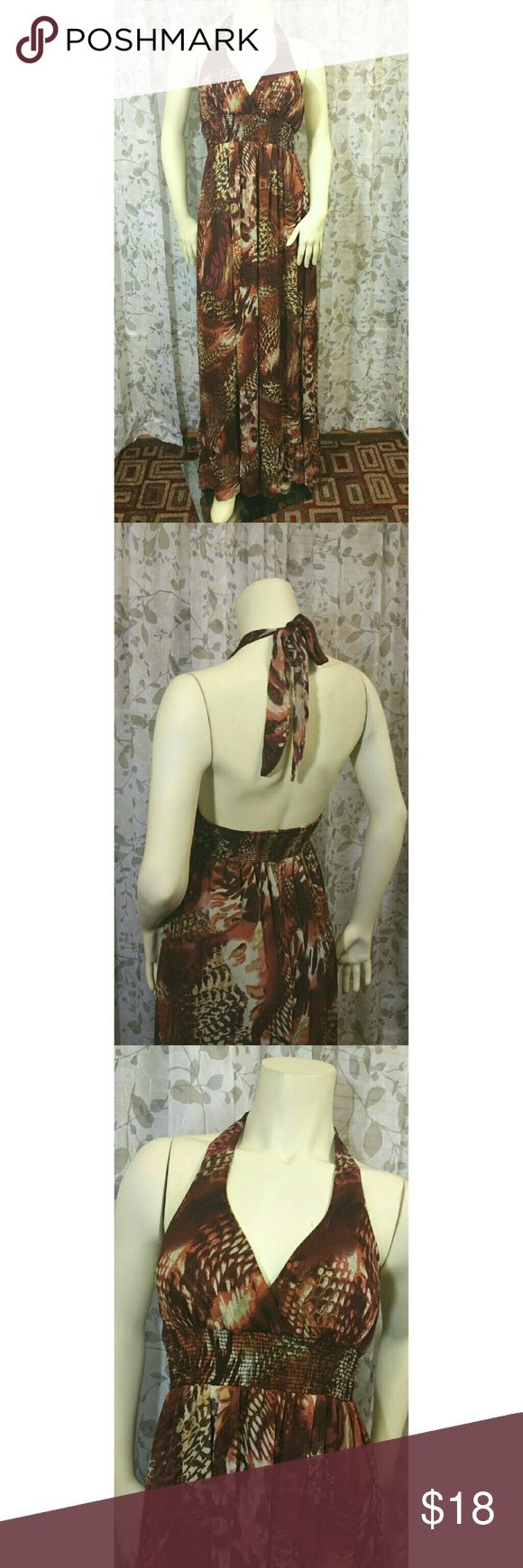 Pretty Long Dress This pretty long dress features an elastic waist, ties around the neck with back out. This fully lined dress has a beautiful animal print. Size Large. Length 56 in. Like new condition. Xhilaration Dresses Backless