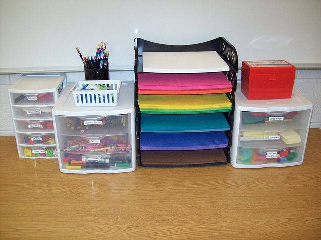 writing center - I like how nice and clean and organized it is. I have to get the little drawers for crayons and markers.