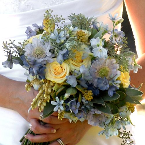 bridal bouquet containing delphinium, blue scabiosa, tweedia, hydrangea, pieris, tuberose, Cream Prophyta roses, seeded eucalyptus, silver tree, wormwood, and succulentsvendors: Floral Verde LLC