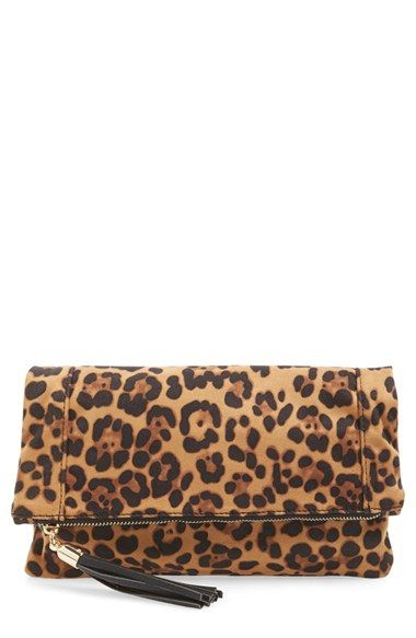 Free shipping and returns on Sole Society 'Tasia' Print Foldover Clutch at Nordstrom.com. A flouncy tassel pull details the zippered flap of a soft print-fabric clutch with a roomy interior.