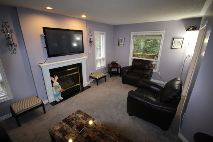 The Family Room with gas fireplace, pot lights and plenty of natural light.