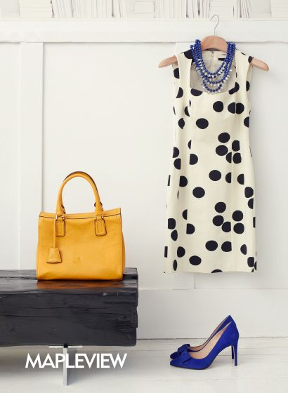 Banana Republic printed dress, blue beaded necklace, Browns Shoes Pourchet mustard handbag, Town Shoes blue pumps