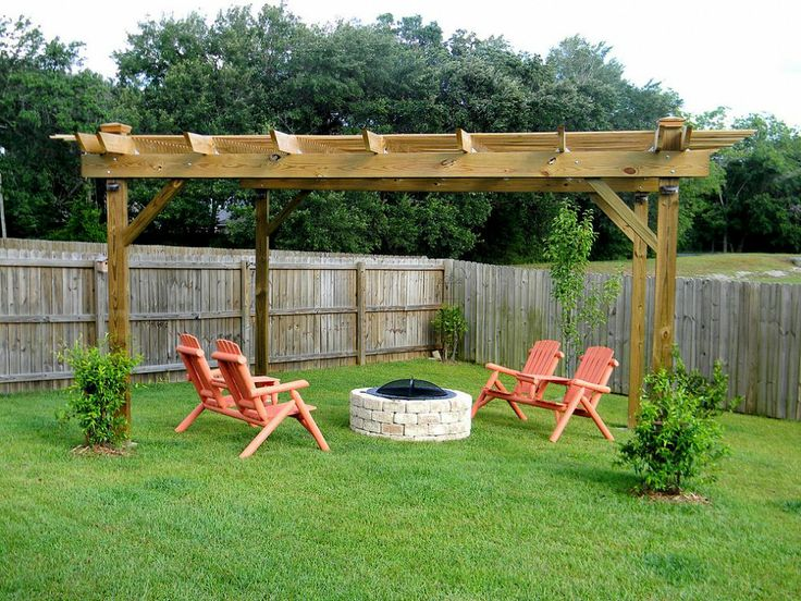 Lovely and simple outdoor seating area with pergola and firepit