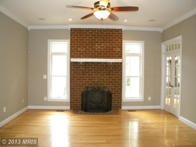 Brick Fireplace, Light wood flooring, Taupe gray walls