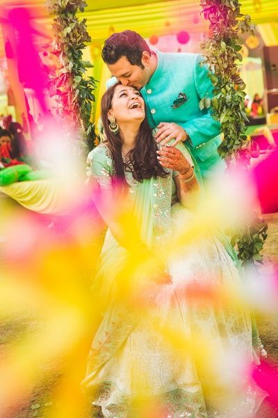 Mehendi outfits, couple portrait, color coordinated bride and groom mehendi outfits, day wedding mehendi, mint green and white lehenga, groom to be outfit, sea green sherwani
