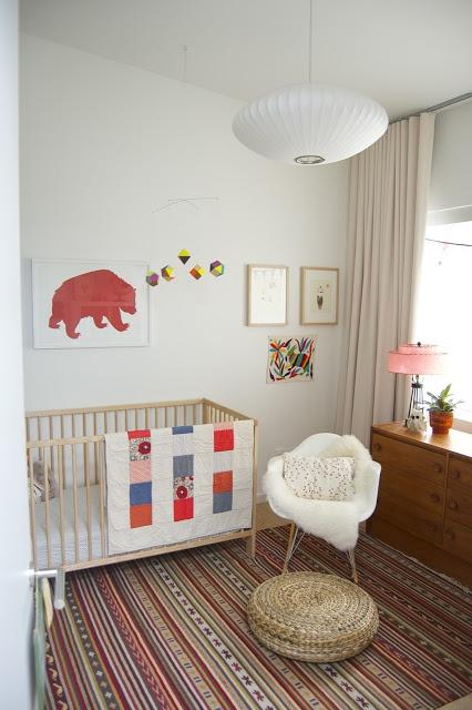 white walls, warm drapes, mid century furnishings