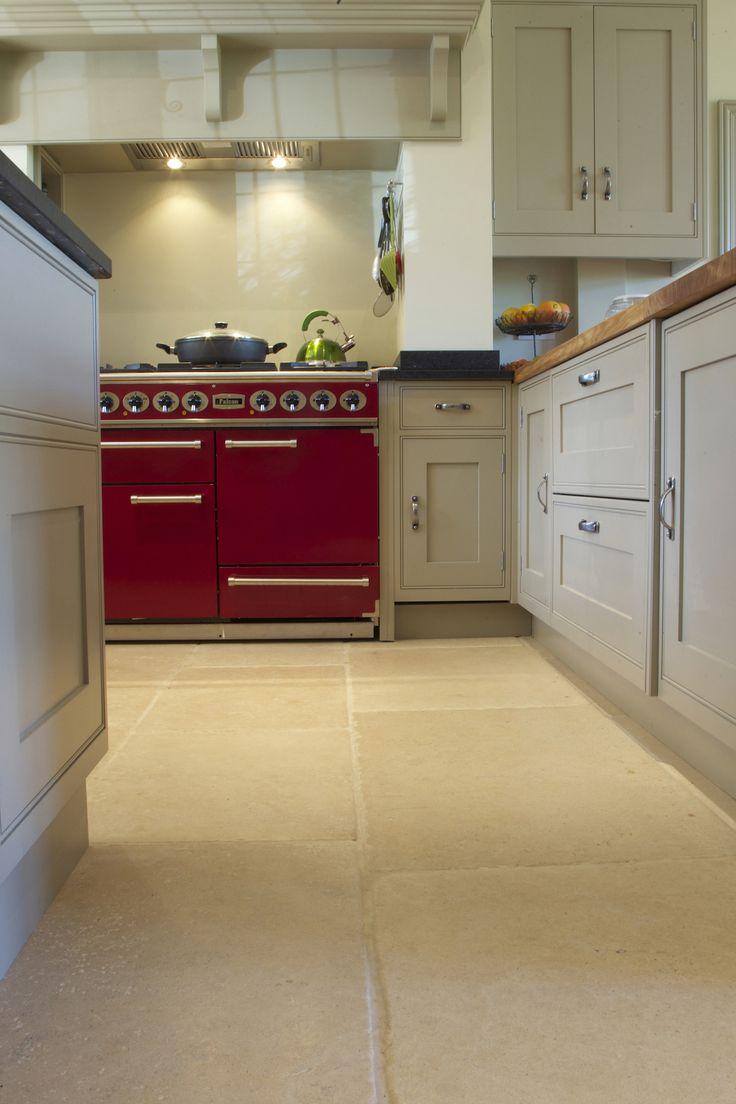 Country kitchen floor using limestone tiles from Artisans of Devizes. www.artisansofdevizes.com