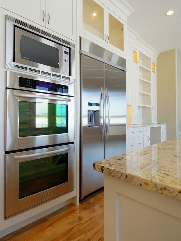 you could put the ovens next to the fridge with a microwave on top.....: