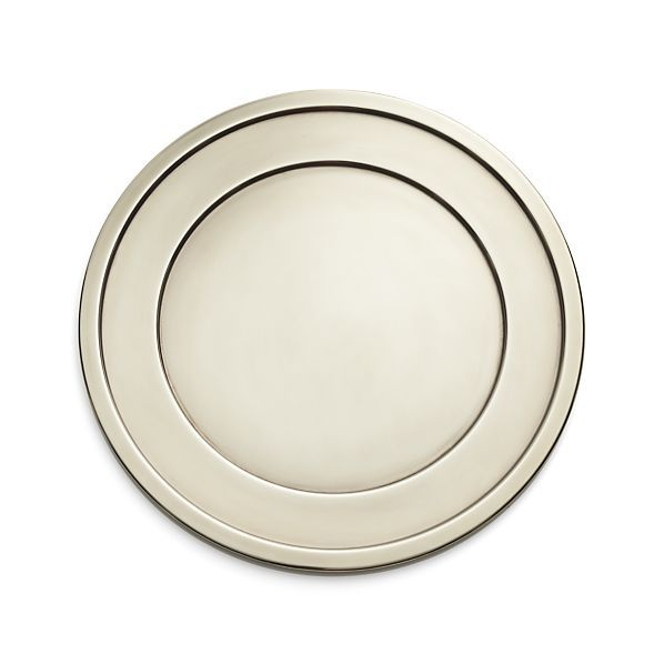 Each handcrafted piece in the Lawrence serveware collection is stamped into shape with a power press by skilled craftsmen and then polished and plated to give it a timeworn, antique look. The stepped rim detailing adds to its classic appeal. Coordinate with matching serving bowl, serving tray, gravy boat, and platter. To keep your serving pieces looking their best, we suggest using MAAS polish to remove fingerprints and oxidation.