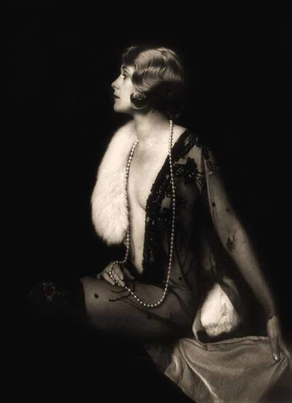 Beautiful black and white composition, with clean profile silhouette and play of textures with fur, pearl strand, and beaded sheer negligee.  7Ziegfeld-Follies-Girls-1920-Broadway-17