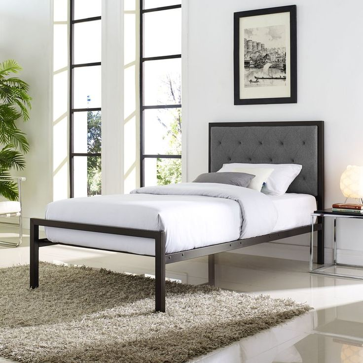 Combining glamor-inspired tufts and a simple frame, this platform bed raises your master suite's aesthetic and exudes on-trend sleep style. The steel frame draws in the eye with its faux leather upholstery and diamond tufts, offering a textural foundation for your bedding vignette. Top it with a gel foam mattress, wrap it with crisp white sheets, then fold over a matching comforter for a clean and classic display. Bolster the look with some color and plush appeal by adding a bundle ...