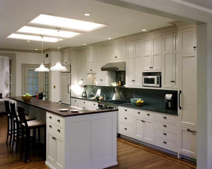 Amazing open galley kitchen design elegant open galley for Best lighting for galley kitchen