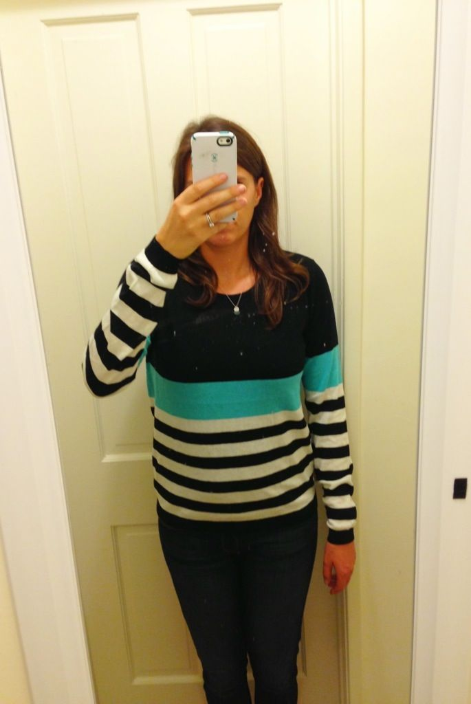 Turquoise block colored sweater.