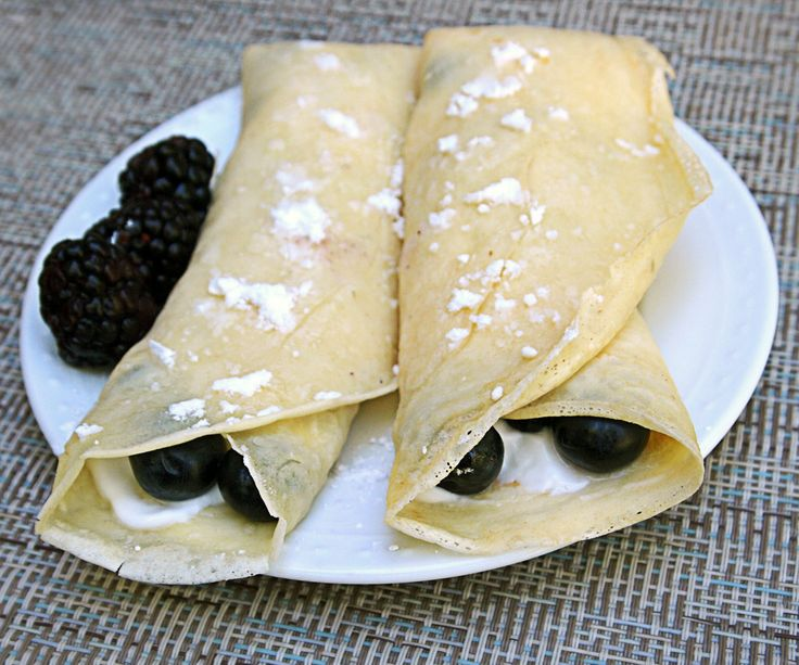 This is a basic crepe recipe that has no butter, fewer eggs than other recipes and is a bit healthier! It's so light and delicious - you'll love it! This recipe has a filling of greek yogurt and blueberries - but you can modify this and fill it with whatever you like! A less healthy option that is delicious is melted chocolate and bananas on the inside - it's so good! Each crepe has about 100 calories, 5g protein, 16g carbs and 119mg sodium <- without toppings.