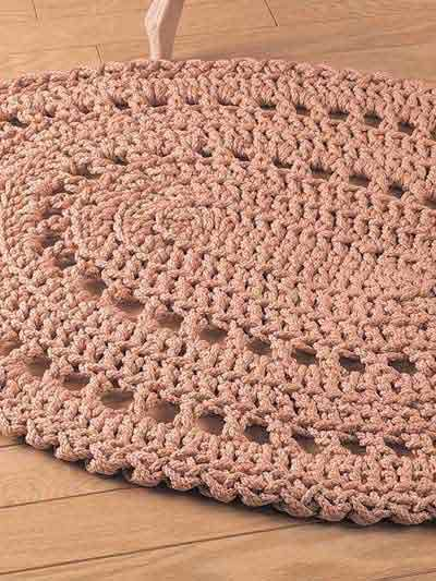 Work this rug up quickly using 6mm craft cord and a size Q hook.    Skill Level: Beginner  Designed by Helen Macoubrie