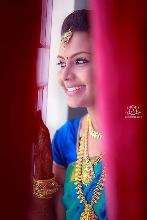 South Indian bride. Temple jewelry. Blue silk kanchipuram sari.Braid with fresh flowers. Tamil bride. Telugu bride. Kannada bride. Hindu bride. Malayalee bride.