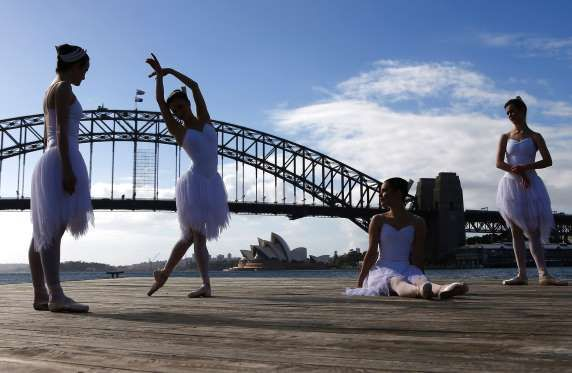 Ballerinas from The Australian Ballet perform on a floating platform, during a promotional event in ... - David Gray/REUTERS